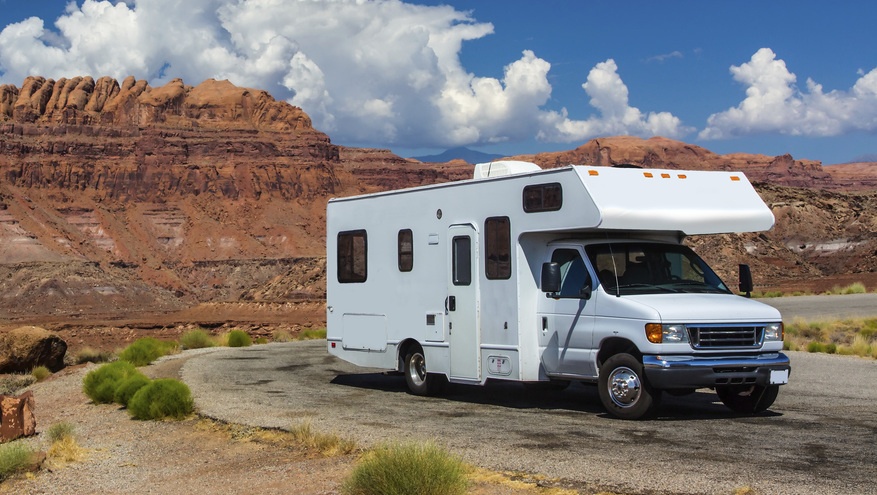 Recreational Vehicle Loan - RV parked on the road with red rock cliffs in the background.